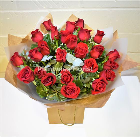 24 Valentines Day Red Roses And Gyp Handtied Bouquet