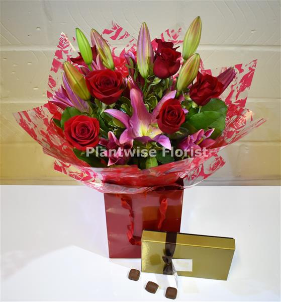 A I Love You Red Rose And Lily Valentine Day Bouquet With Chocolates